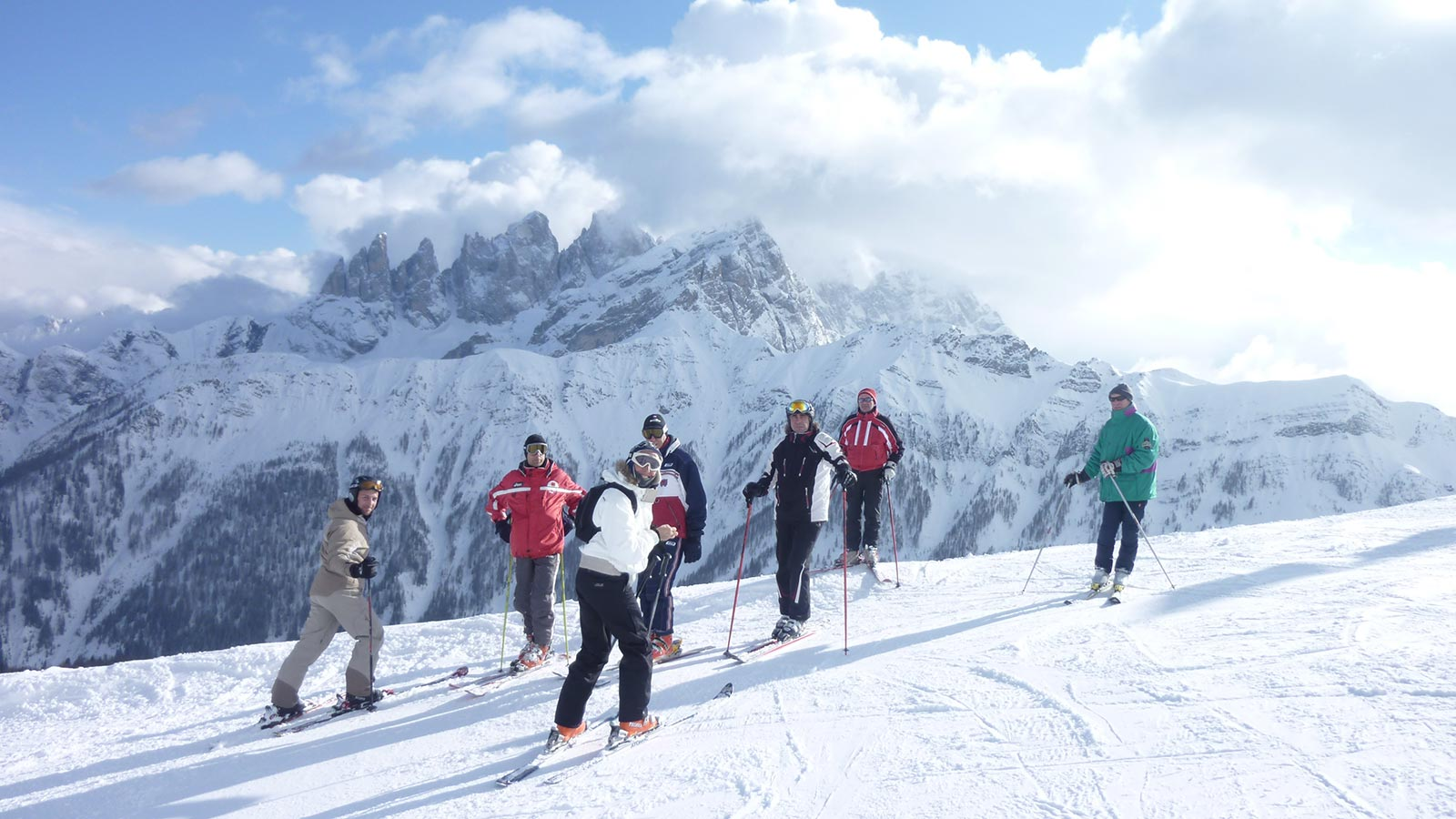 a group of skiers right before descending